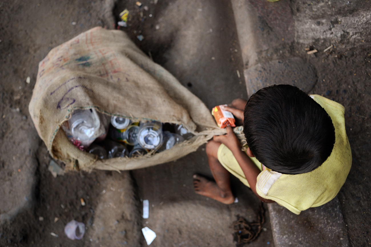 A dalit child collect the floor plastic bottles in the Kolkata streets, near the Howrah Junction railway station.