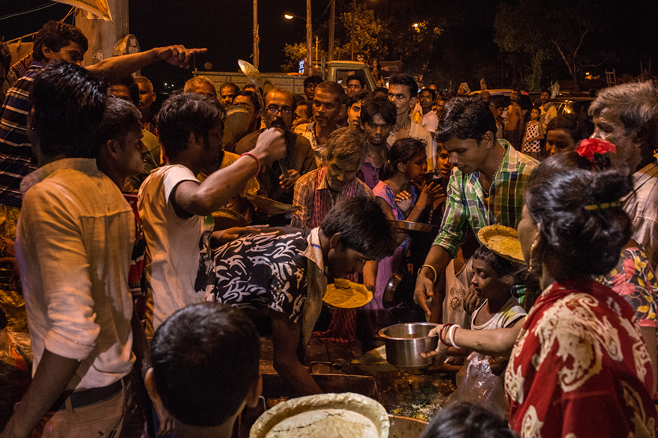 Near the Ganga Crematory slum many dalit in the night receive food by religious care organizations.